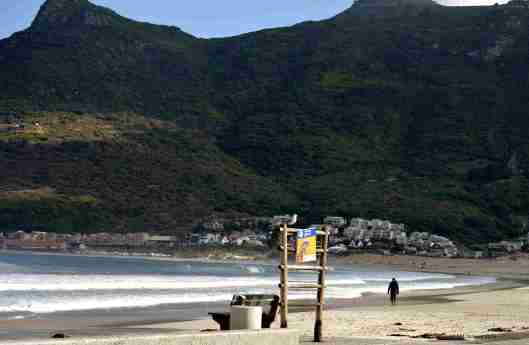 The sheltered bay of Hout Bay has a white sand beach, a popular attraction for tourists and locals alike